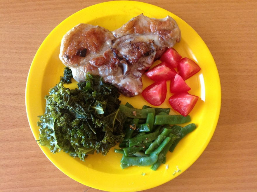 Dinner with fatty cut of pork chop, kale, and homegrown beans and tomatoes