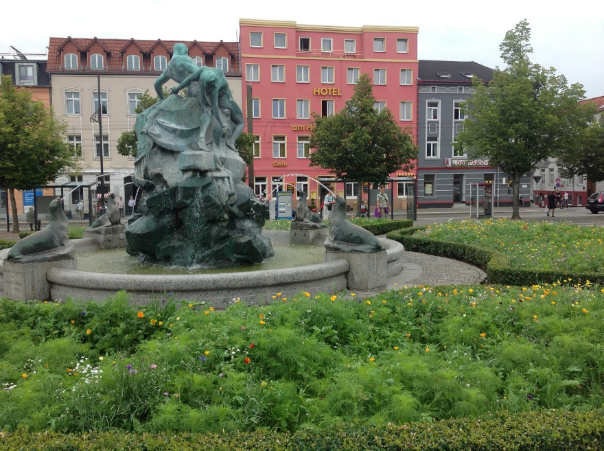 Garden in front of the train station with our pink restaurant behind