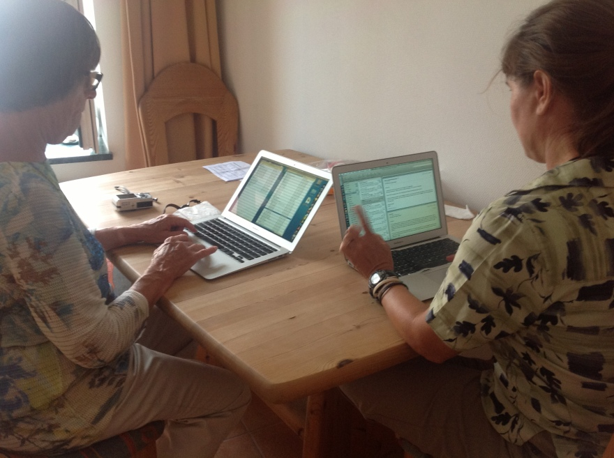 Suzi and Eva try to catch up with emails in the kitchen