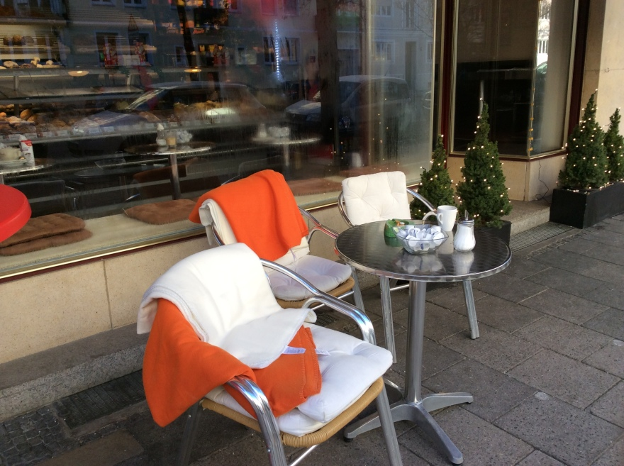 Sidewalk cafe with blankets