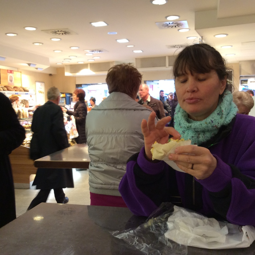 Suzi exploring the innards of her deli wrap.