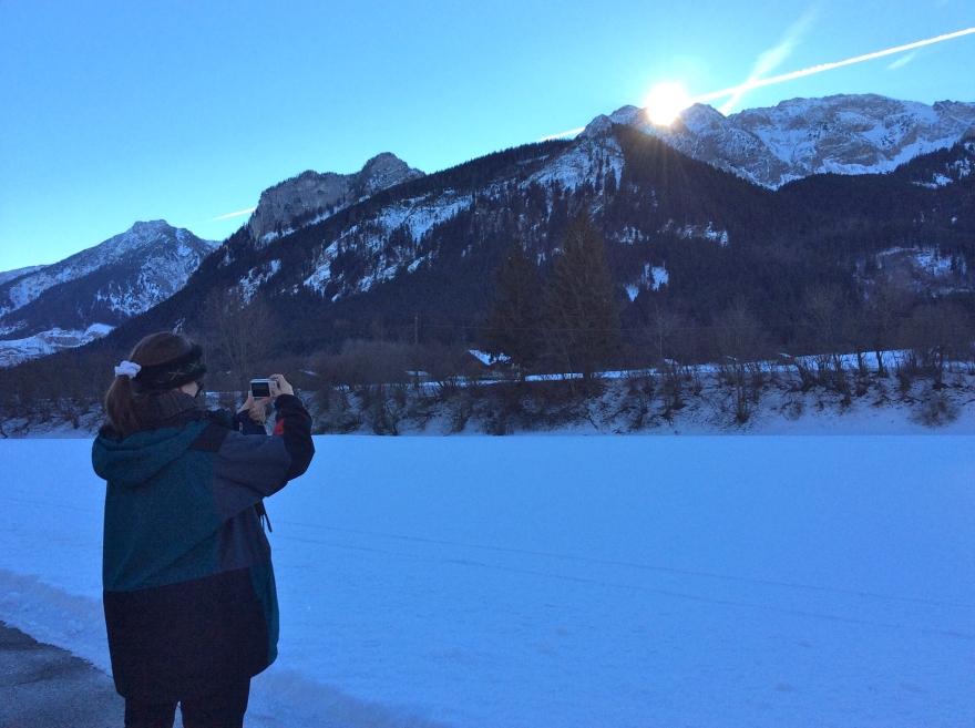 Suzi takes a shot of the rising sun.
