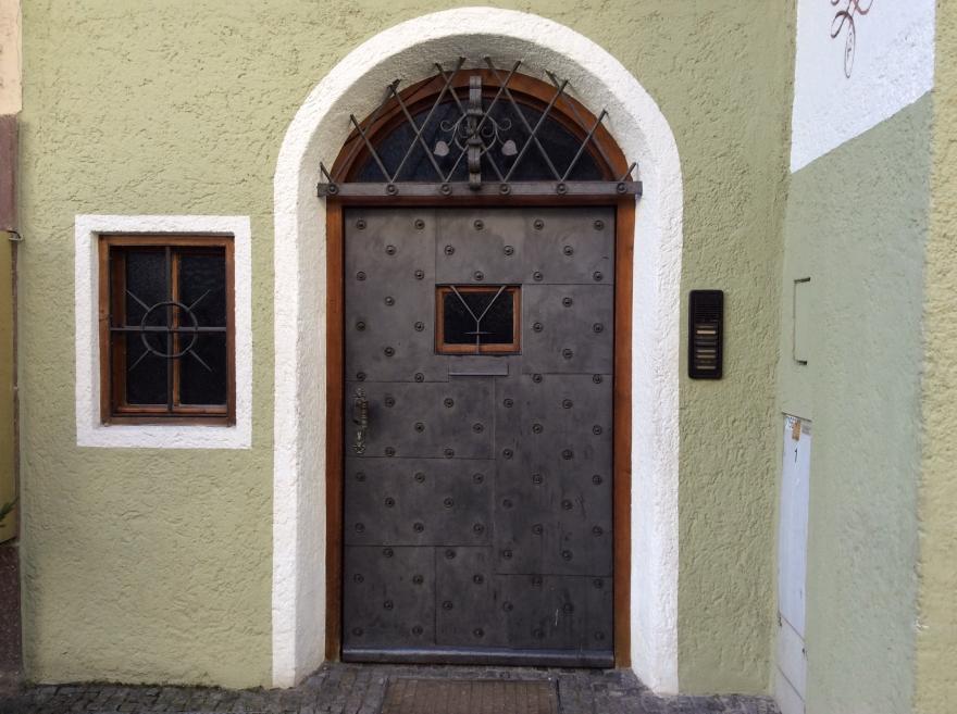 A formidable iron door.