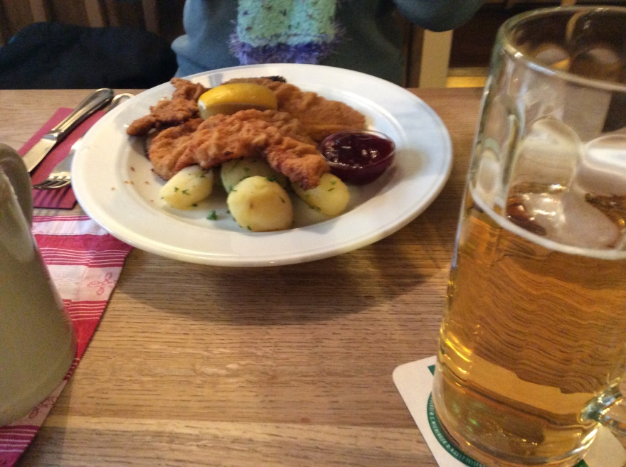 A real veal cutlet Wienerschnitzel with parsley potatoes and a wedge of lemon. And a fine local beer.