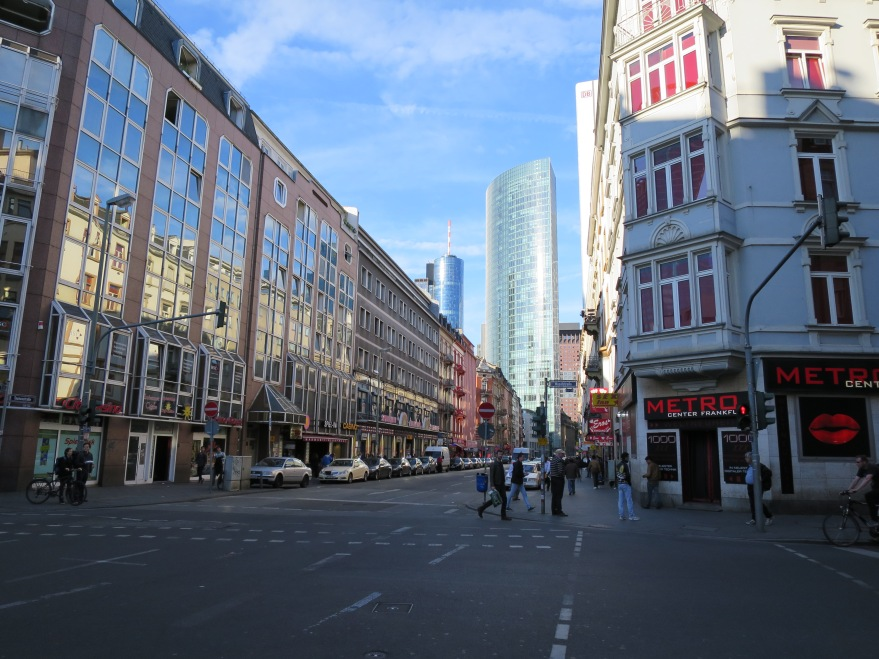 Red light district, with financial district skyscrapers beyond
