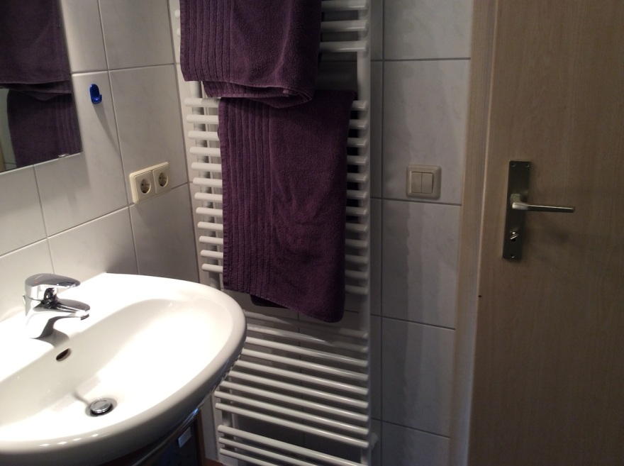 Bathroom with heated towel rack, great in winter where it becomes the room heater.