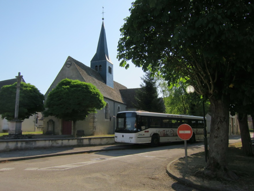 The village church on the traffic circle, with the bus to Beaune and life beyond.