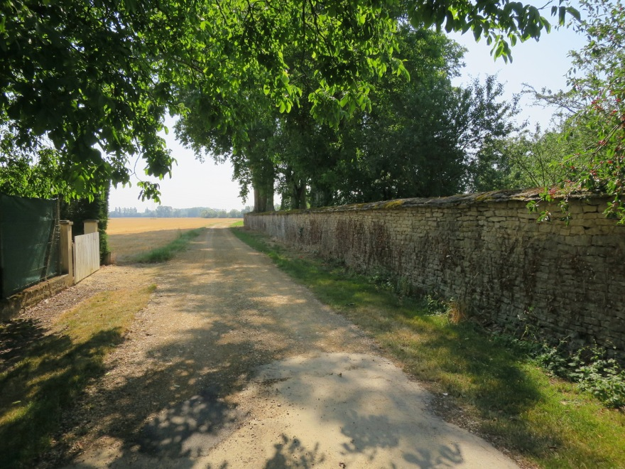 The end of the chateau wall, at the edge of the village