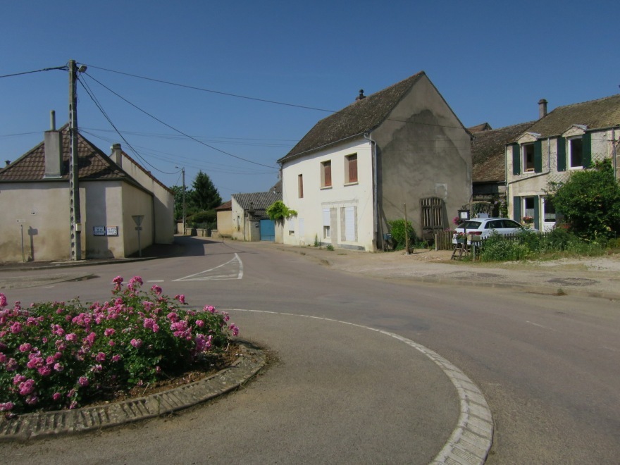 The village center with its traffic circle, and our gîte on right