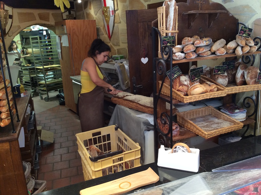 The woman is slicing off a 300 gram piece for us from a loaf that originally was nearly two meters long.