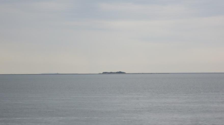 Hallig Oland on the Horizon