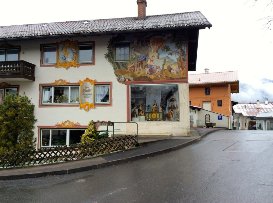 A house decorated with trompe d'oeil, Lüftlmalerei in German.