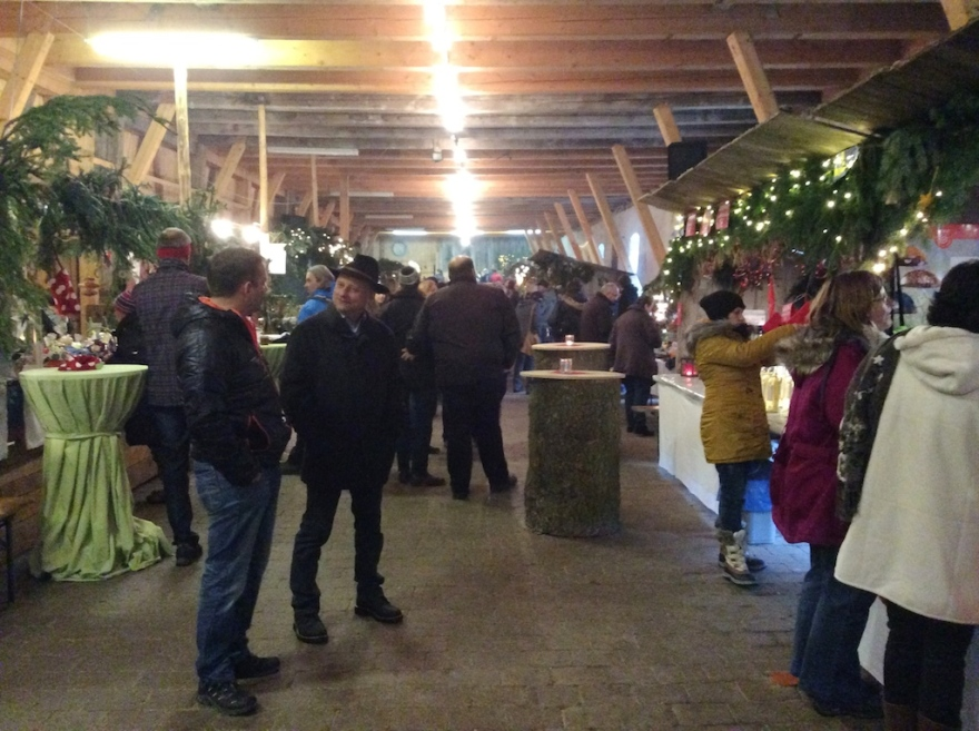 Artisan booths inside the barn, quite festive
