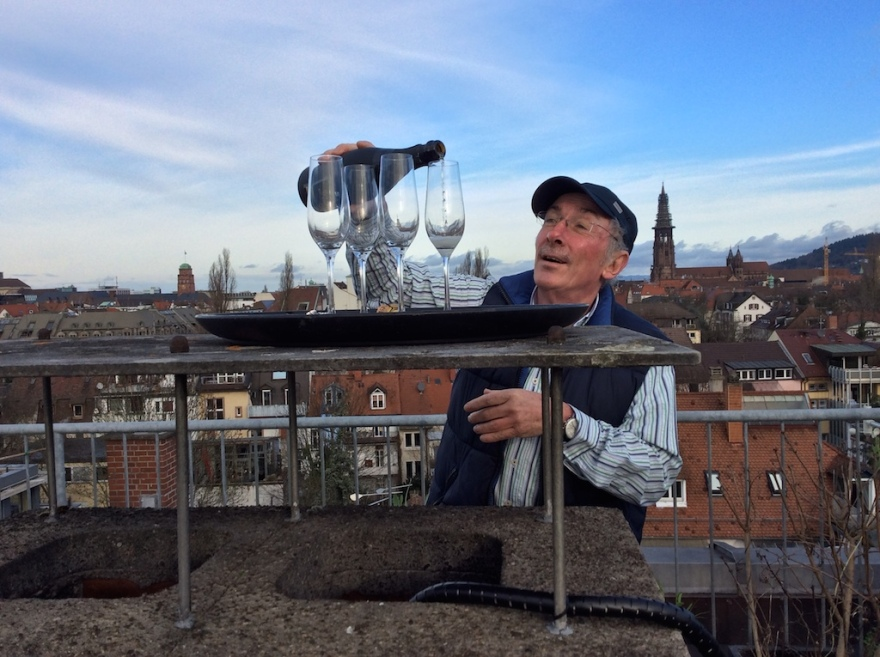 Peter pours the bubbly on the rooftop terrace.