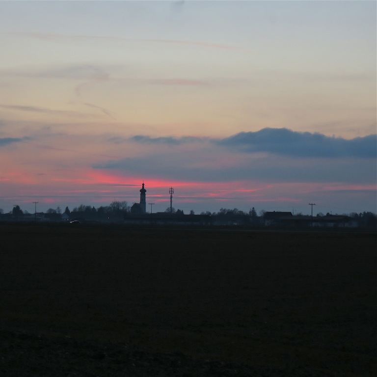 In the distance is a typical Bavarian church