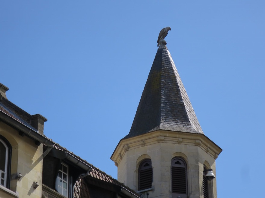 The namesake falcon, perched permanently on the city hall spire.