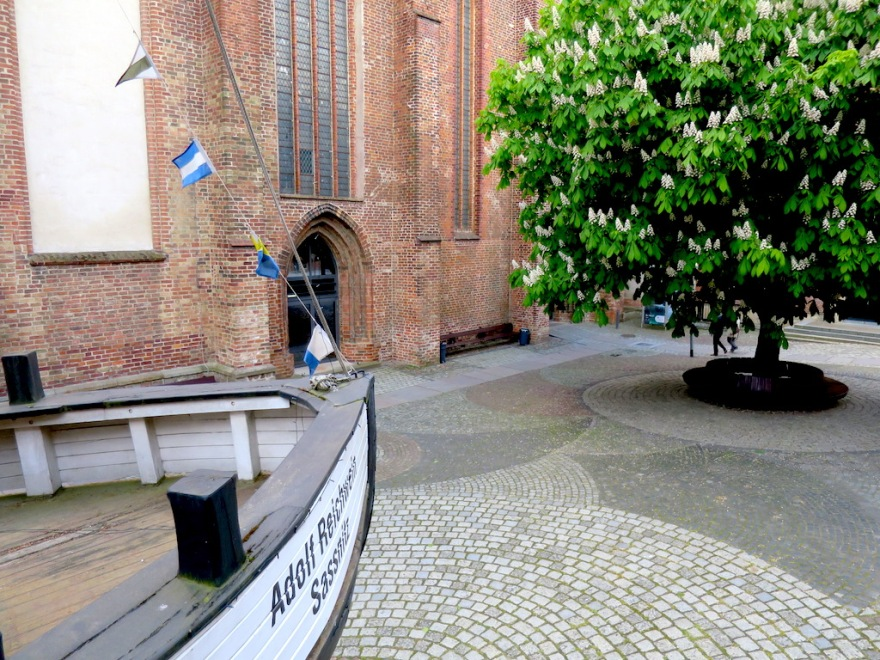 The church/museum entry with an old wooden boat in the courtyard.
