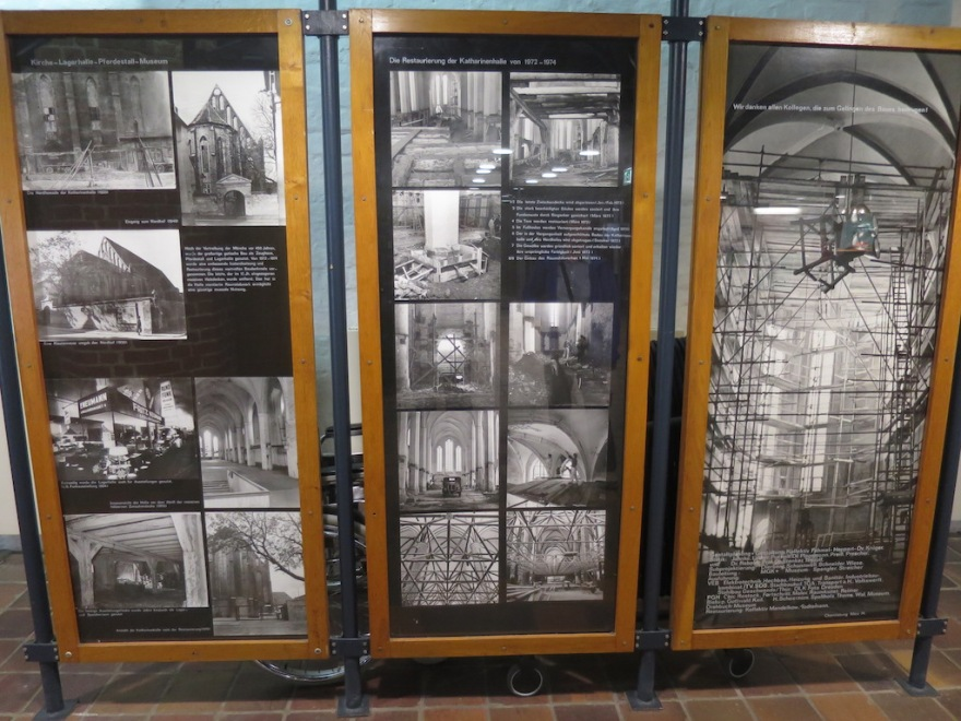 Photo display of war's destruction, and rebuilding