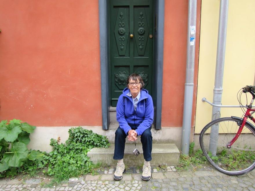 Eva takes a rest at a very narrow house