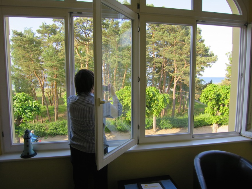 Eva keeps her eye on the sea from our terrace.