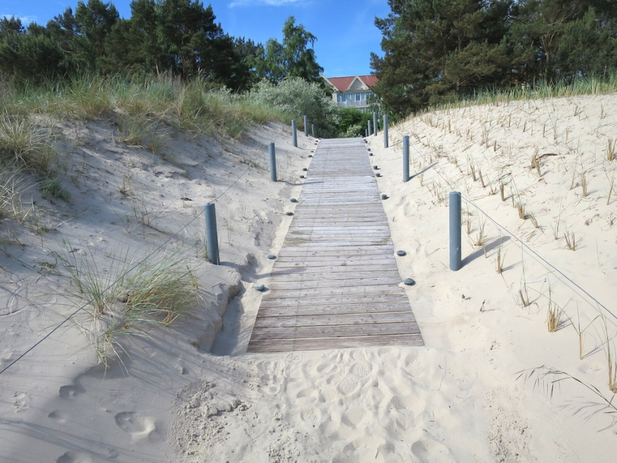 Boardwalk freshly swept clean of drifting sand