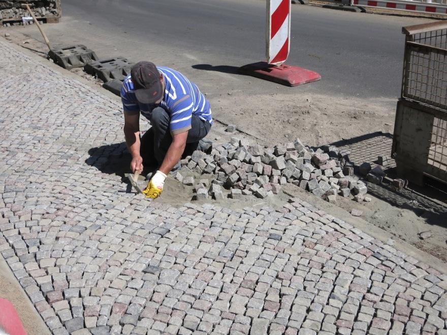 Skilled mason repairing a sidewalk