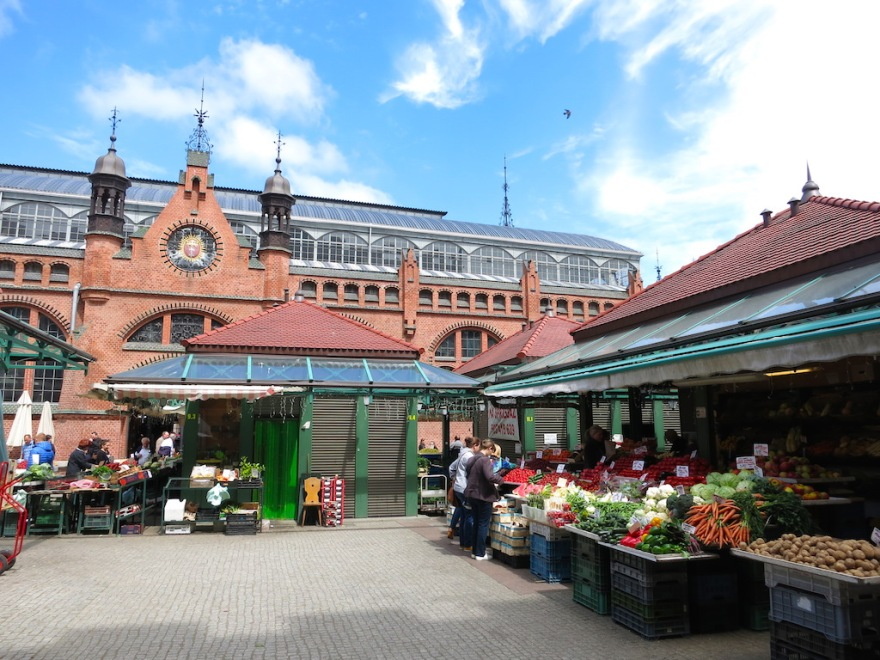 Daily outdoor produce with covered market behind