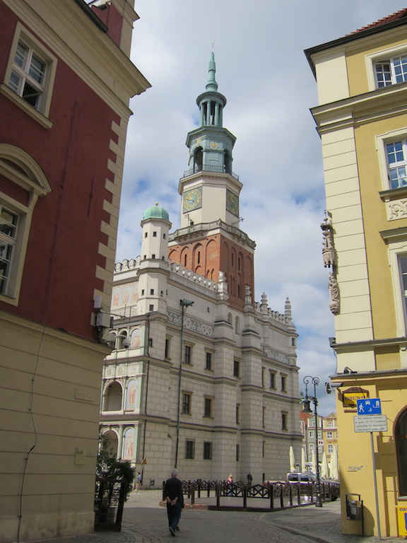 The imposing city hall was not located in the center of the square but rather near one corner.