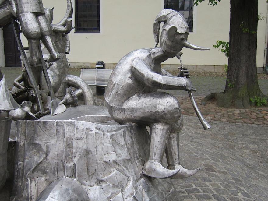 The flutist plays a sad tune.
