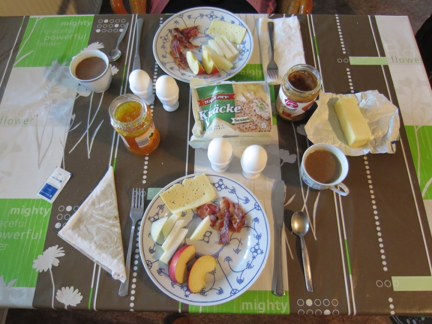 Our typical homemade breakfast - egg, bacon, cheese, fruit, veggie and coffee. Sometimes bread, butter and jam, too.
