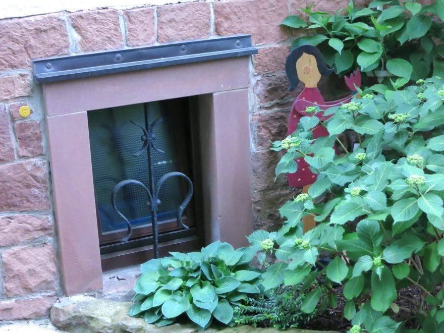 Basement window is guarded