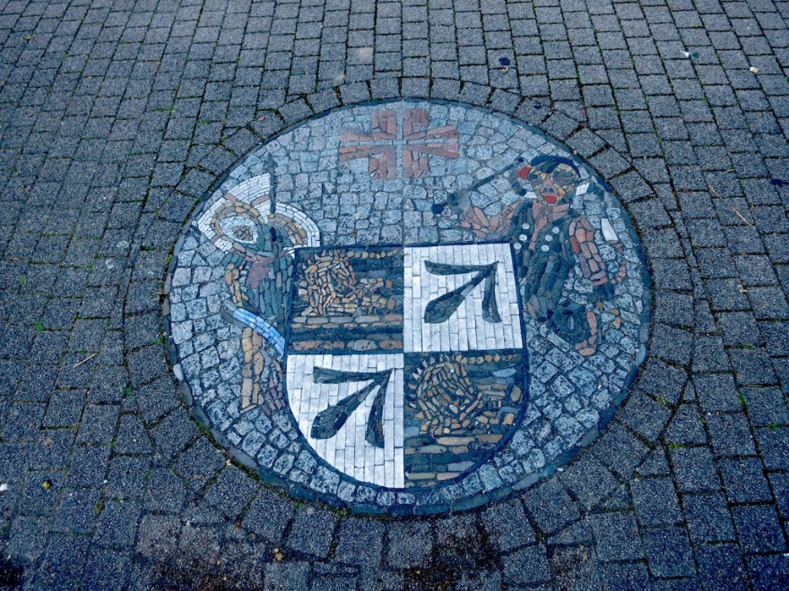 Tile decoration in the cobble sidewalk
