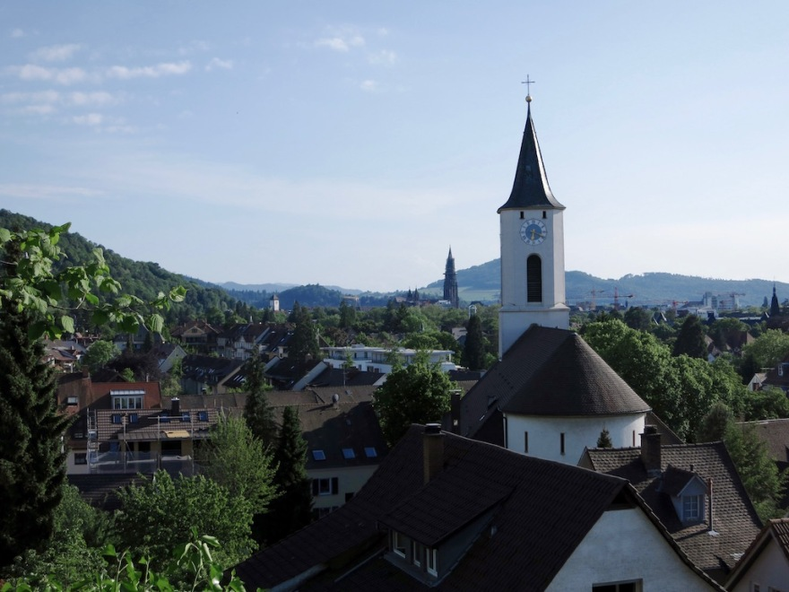 View over Freiburg, our church nearby with The famous Freiburg cathedral in the background.