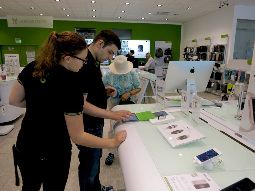 Apple reseller store personnel helped us with a technical problem.