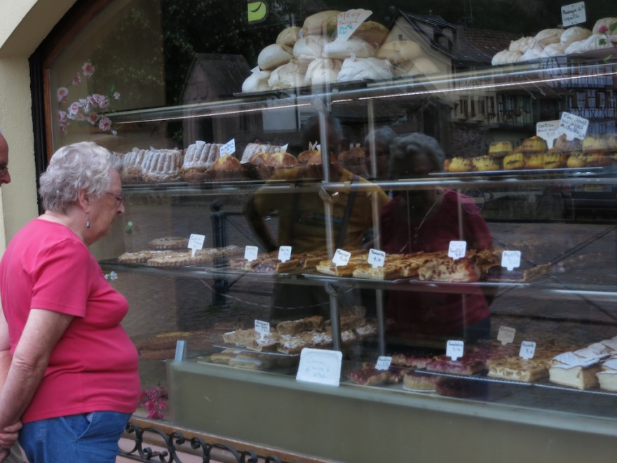 Woman eyes the pastries