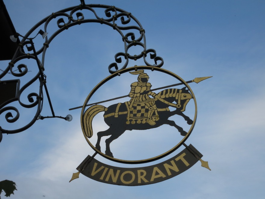A winery sign  with a traditional knight's motif.