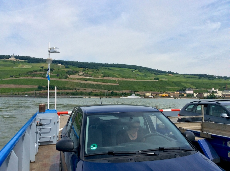 We cross the Rhine River by ferry.