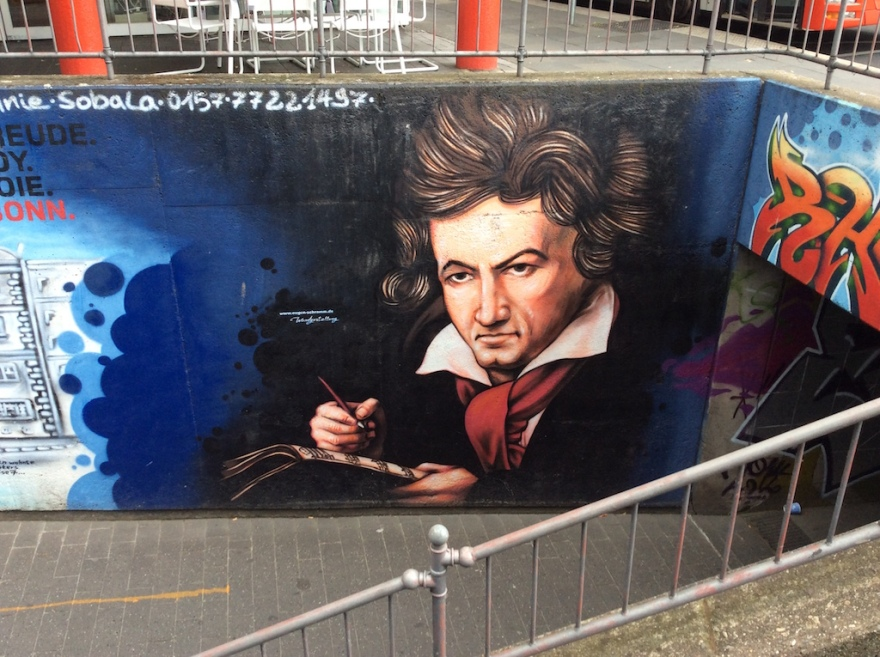 Beethoven glares at passersby near a subway entry.