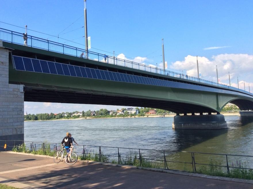 A heavily traveled bridge crosses the Rhine.