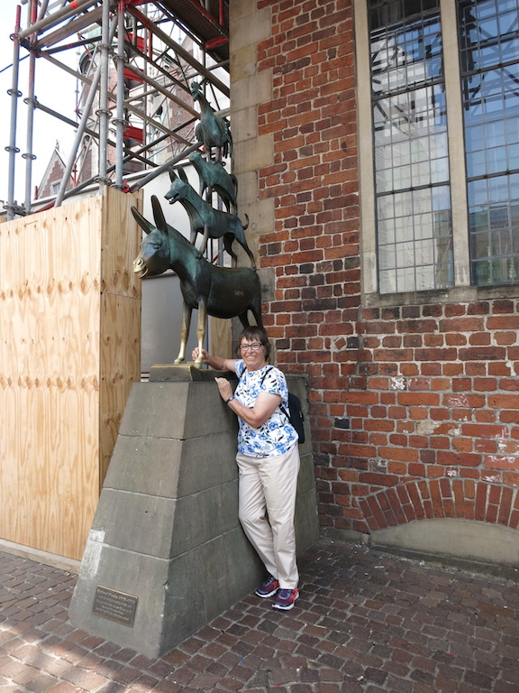 Eva stands beside a  sculpture depicting the characters in a famous Grimm fairytale.
