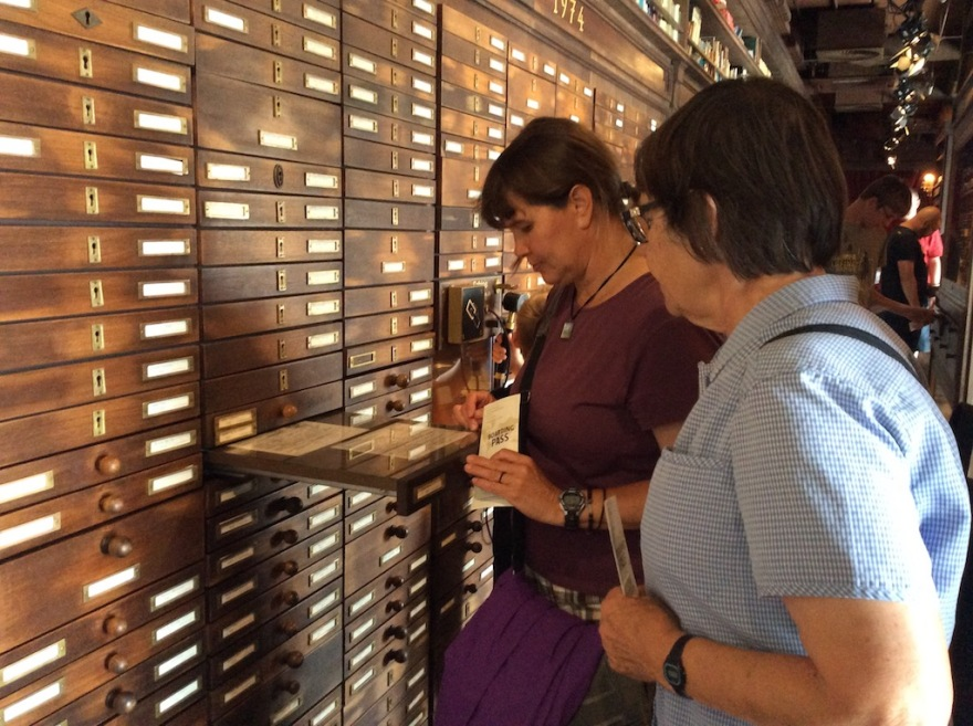 Eva and Suzi look through old record drawers.