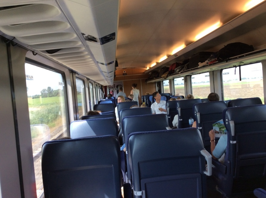 Comfortable fast train whisks us through beautiful countryside.
